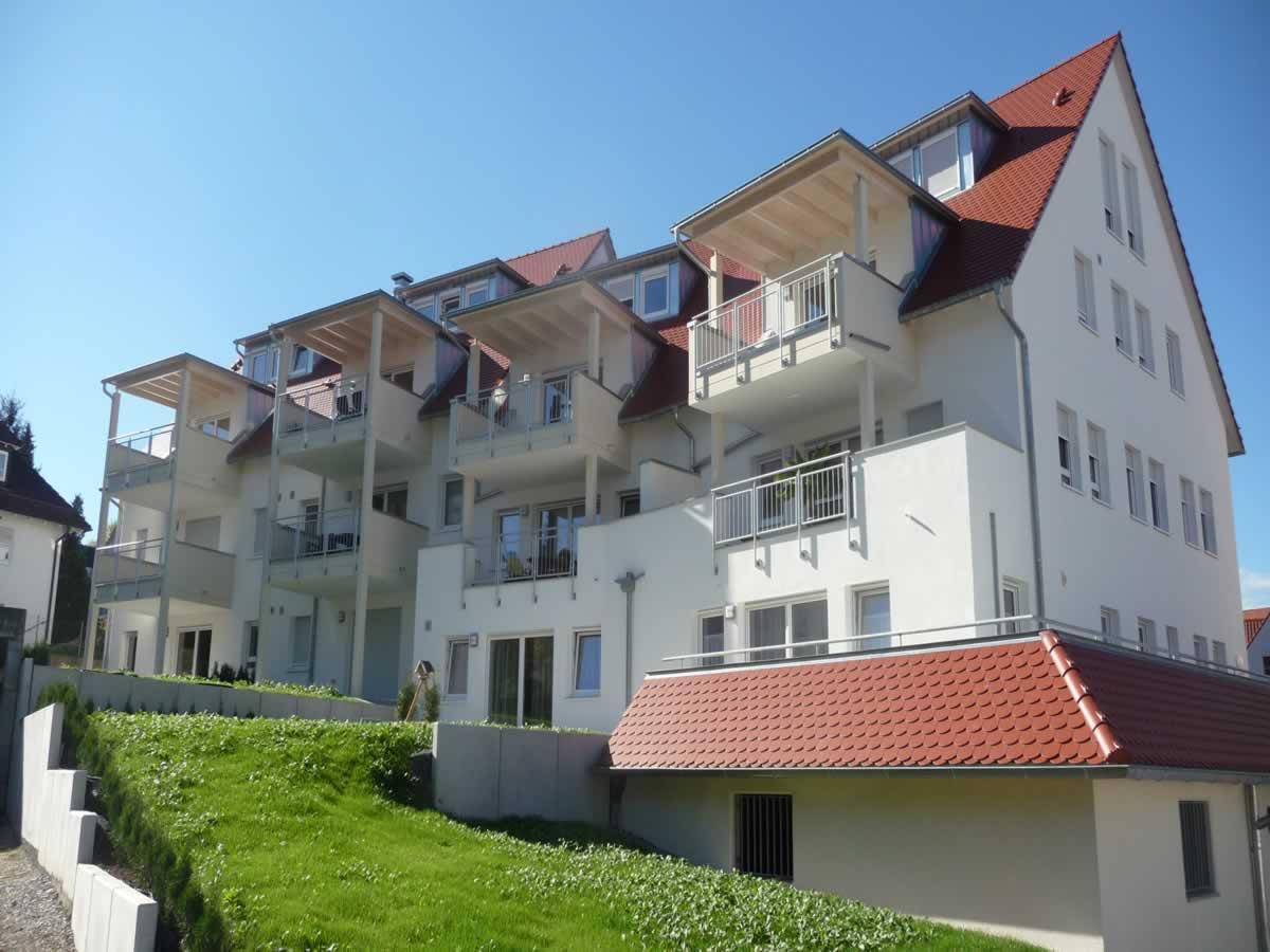 Neubau Mehrfamilienhaus mit Tiefgarage und Carports - Bild2