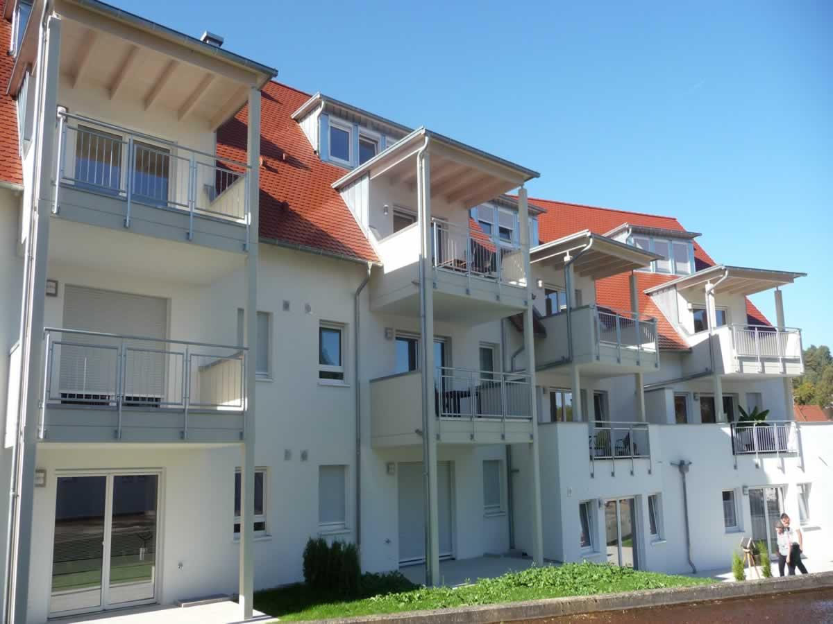 Neubau Mehrfamilienhaus mit Tiefgarage und Carports - Bild3
