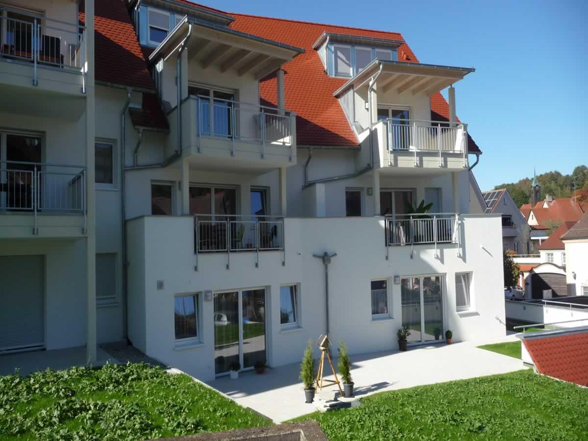 Neubau Mehrfamilienhaus mit Tiefgarage und Carports - Bild4