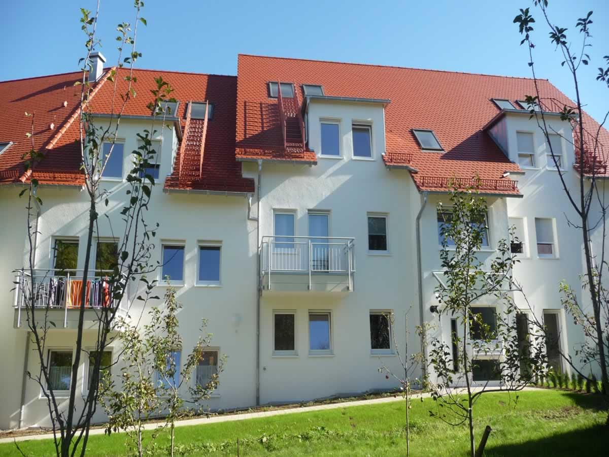 Neubau Mehrfamilienhaus mit Tiefgarage und Carports - Bild5