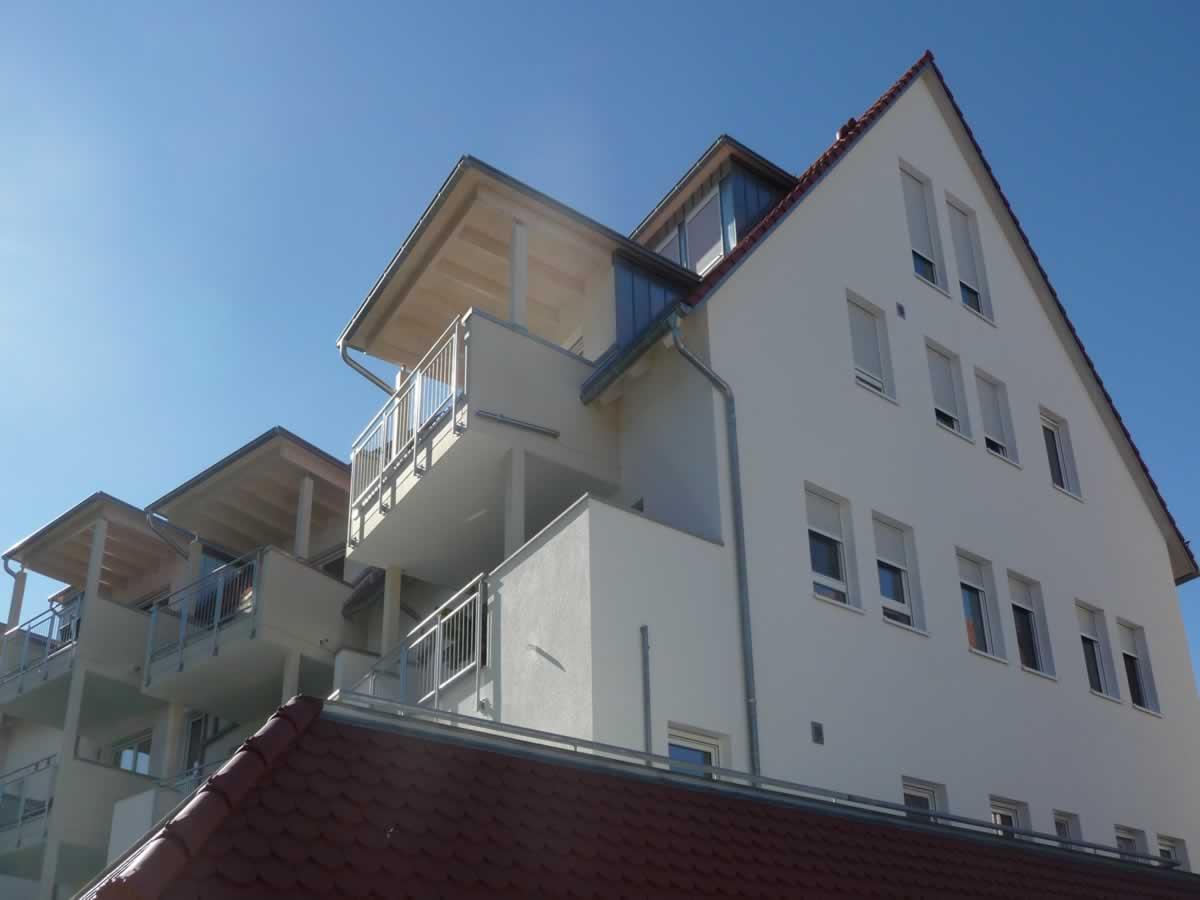 Neubau Mehrfamilienhaus mit Tiefgarage und Carports - Bild6